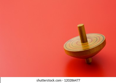 Old wooden spinning Top of classic toy