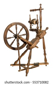 Old wooden spinning wheel isolated on white