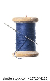Old wooden spool of thread and a needle. Sewing