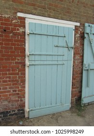old wooden stable doors on a farm UK