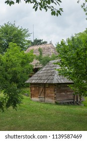 an old wooden stables in the courtyard near the same house, covered with a reed roof in the museum of folk architecture and everyday life. Uzhhorod Ukraine
