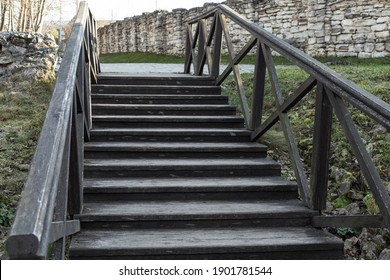 Old wooden staircase leading up, rustic staircase with steps and wooden railings, homemade construction