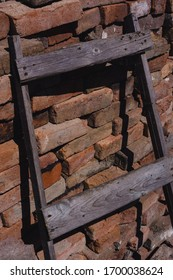 old wooden staircase on the background of a brick wall, brickwork, orange stones