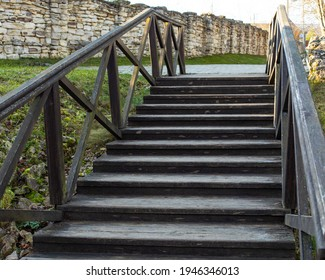 Old wooden staircase with railing, rustic staircase with steps, background backdrop design