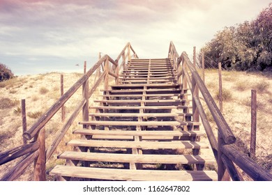 old wooden stairs on sand dunes  to ascent to heaven.Concept