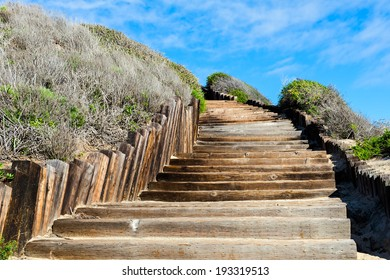 Old wooden stairways to the see beach, but it looks like a stairways to sky or stairways to haven