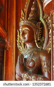 old wooden statue in a buddhistic temple