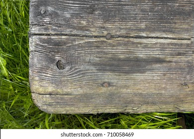 Old wooden step and grass, overhead cropped view