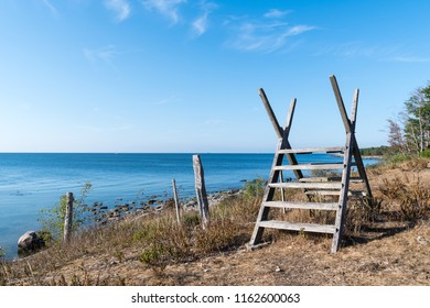 Old wooden stile by seaside at the swedish island Oland in the Baltic Sea