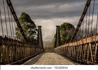 Old wooden suspension bridge.