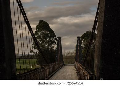 Old wooden swing bridge