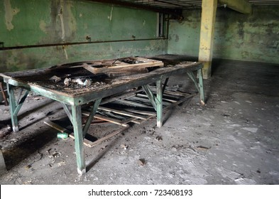 Old wooden table in abandoned insane asylum hospital