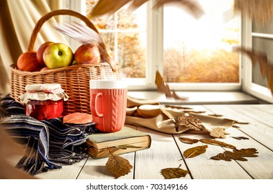 Old wooden table by the window in the autumn beautiful day