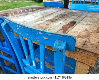 old wooden table and chairs