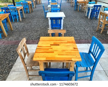 Old wooden table and chairs in a cafe