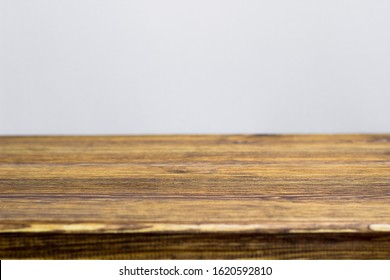 Old wooden table on a white background