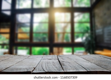 old wooden table space platform and blurred resturant or coffee shop background for product display montage