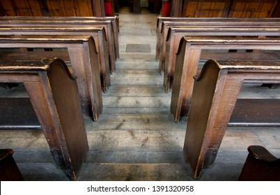 Old wooden tiered church pews from above - image