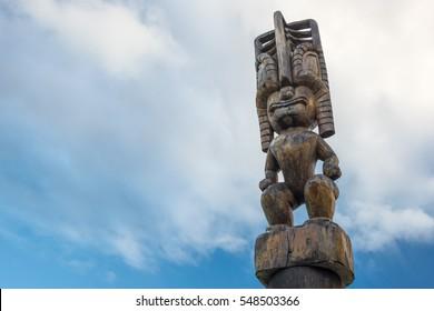 An old wooden Tiki god watches over sacred grounds on Kauai, Hawaii