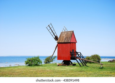 Old wooden traditional windmill by the coast of the swedish island Oland
