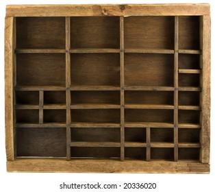 Old wooden typesetter case (drawer) isolated on white