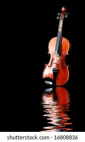 old wooden violin reflecting in water waves
