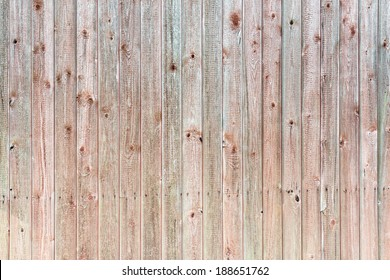 Old wooden wall background in red and green colors, barn in Sweden
