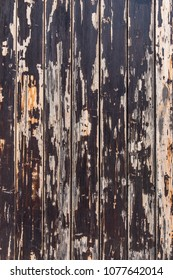 Old wooden wall with peeling paint background