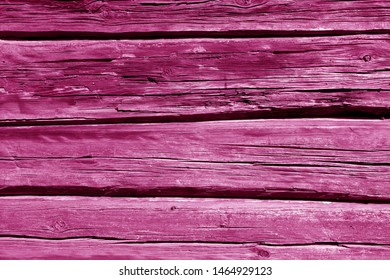 Old wooden wall in pink color. Abstract background and texture for design.