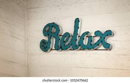 """Old wooden wall with visible texture with rustic denominational sign """"Relax"""""""