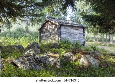 Old Wooden warehouse, barns, sheds in the forest. Stones, rocks this side.