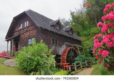 Old wooden water mill in Frutillar village, german colonial museum, lake Llanquihue, southern Chile