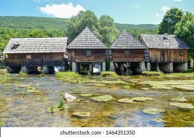 Old wooden water mills on river Gacka springs