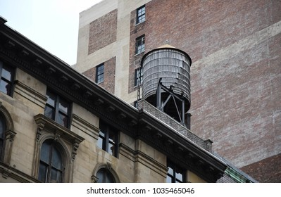 An old, wooden water storage tank in Manhattan, New York City, USA