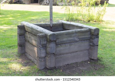 Old wooden well in the farmyard yard