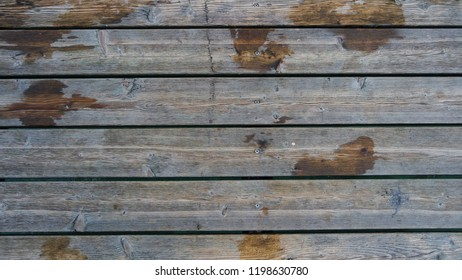 Old wooden wet jetty deck background lumber pattern