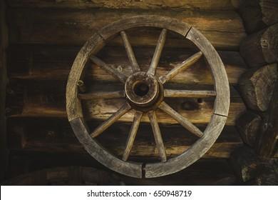 Old wooden wheel in countryside neighborhood