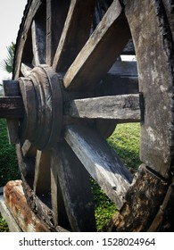 An old wooden wheel from a ladder, wheel from a wooden wagon from ancient times.