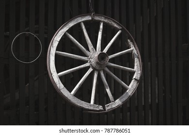 Old wooden wheel on the fence