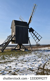 Old wooden windmill at the island Oland in Sweden by winter season
