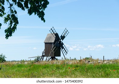 Old wooden windmill the symbol for the island Oland, the island of sun and wind in Sweden