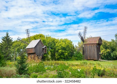 Old wooden windmills looking to a forest. Pereyaslav, Ukraine.