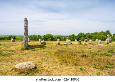 Old wooden windmills and stones on the island Oland, Sweden.
