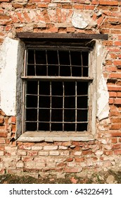 Old wooden window in abandoned building, brick wall
