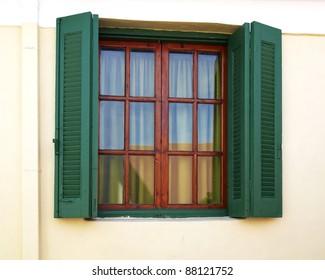 old wooden window, green shutters