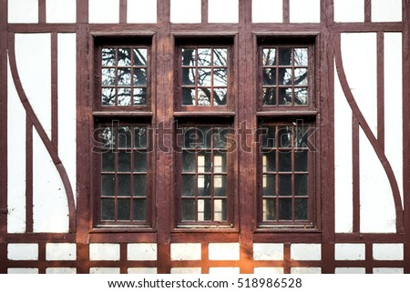 Old wooden window, with lines and curves.
