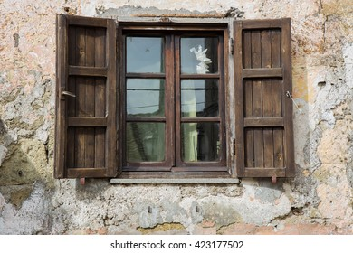 Old wooden window open