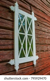 Old wooden window and red ochre painted timber wall
