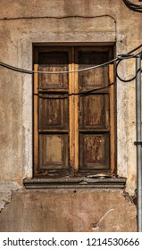 Old wooden window shutters in a grunge facade in Sardinia, Italy