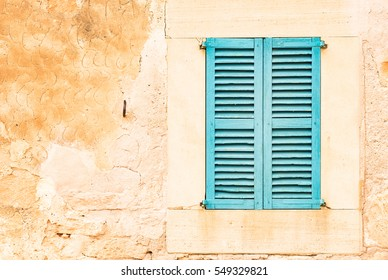 Old wooden window shutters of an mediterranean house, vintage background.